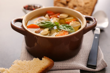 Casserole with delicious turkey soup on napkin