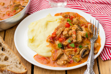 Hungarian meat stew Porkolt with veal and sweet pepper