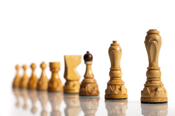 White chess pieces on a white background