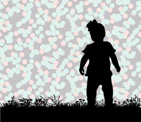 silhouette of a child playing on the grass