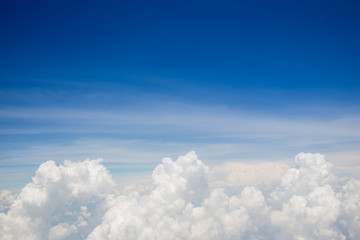 Photograph of a group of cloud and beautiful clear blue sky in above angle view background.