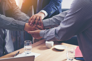 Business people join hands support together concept