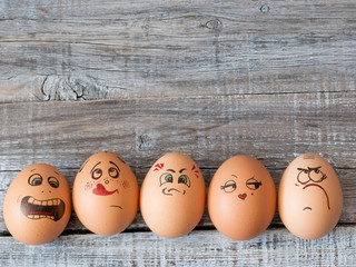 Eggs with painted faces. Photo for your design. Concept of joint recreation