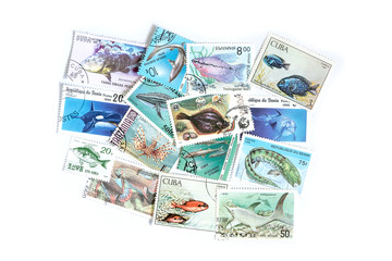 A set of postage stamps printed from different countries.