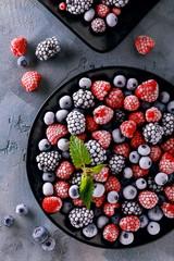 Frozen juicy and ripe berries of blueberries, blackberries and raspberries, top view. Home Harvest