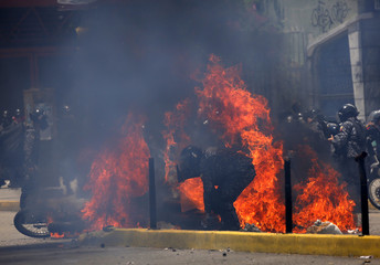Flames erupt as clashes break out while the Constituent Assembly election is being carried out in Caracas