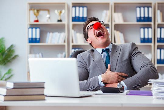 Clown businessman having fun in the office