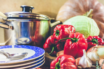 Set of vegetables plates and saucepan