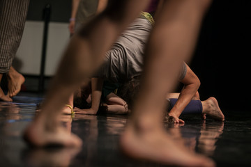 dancers foots, legs,dacers legs, barefoots in motion  near floor on blurred background