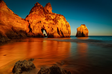 Canvas Prints Cuban Red A long exposure, golden hour sunset picture of the Alvor beach in Algarve, Portugal