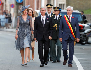 Belgium's King Philippe and Belgium's Queen Mathilde attend the Last Post ceremony during a commemoration at the Menin Gate to mark the centenary of Passchendaele