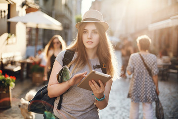 Young woman lost in the city, travelling across the globe. Joy of sightseeing in her eyes. Travel lifestyle concept.