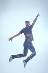 Excited bearded guy feeling freedom during flight