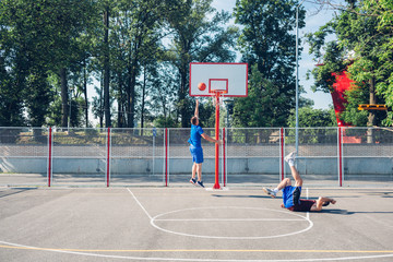 Sportsmen playing Basketball