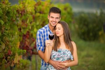 Couple celebrating their anniversary and holding each other in vineyard