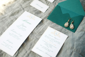 Wedding invitation cards, envelope and menu with bridal earrings
