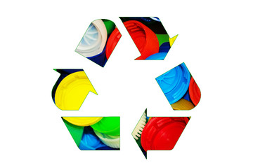 Recycle sign logo made of colorful bright bottle caps isolated on white background. Eco concept