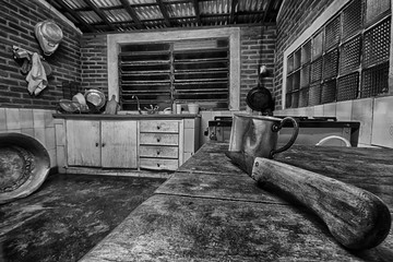 Aluminum mug in an old farm kitchen black and white photo