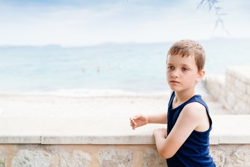 Thoughtful little boy on summer vacations