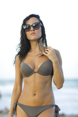 Woman in sunglasses and bikini