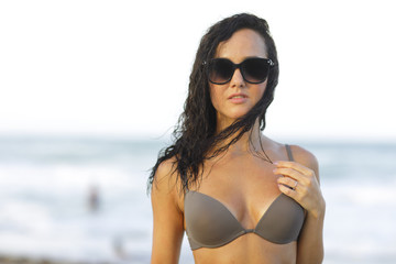 Woman in bikini wearing shades