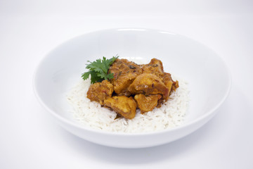 Chicken Curry In A Bowl With White Basmati Rice And Cilantro