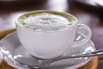 Hot matcha green tea latte glass with milk