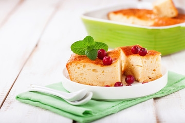 Cottage cheese casserole on a light background. Selective focus. Copy space