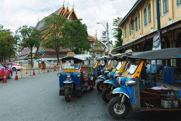 Thailand Tourist enjoys the ride in Tuk-Tuk in Bangkok, Thailand.