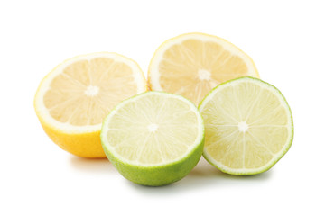 Ripe limes and lemons isolated on white