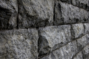 Gray stone wall. Textured background closeup.