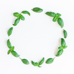 Basil wreath. Fresh green basil on white background. Flat lay, top view, copy space