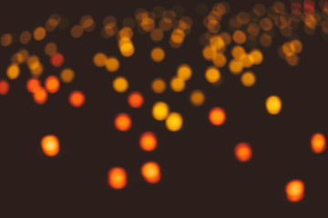 Abstract background of blurred lights with bokeh effect.