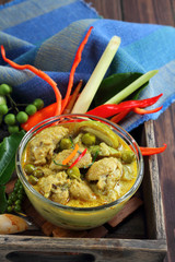 Chicken drumstick green curry food.
