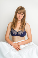 Attractive young woman in bed after sleeping