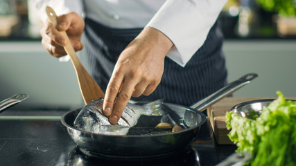Famous Restaurant Chef Turns Over Fish on a Hot Pan. Close-up Shot of Pan with Picturesque Vegetables Seen.