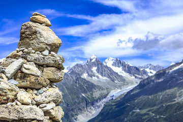 Aluminium Prints Reflection cairn in the foreground and alps range