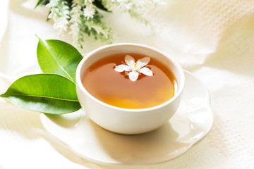 Close up organic tea in white cup with green leaf , Tea ceremony time concept