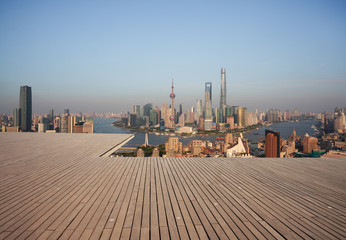 Empty wood floor with city landmark buildings of Shanghai Skyline