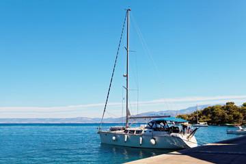 Yatch moored in the harbor near a small town - Croatia, island Brac