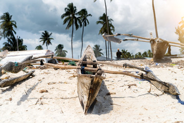 Printed kitchen splashbacks Zanzibar old wooden fishing boat with paddles on a beach of fishing village in Zanzibar