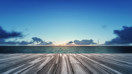 wooden deck with sunrise over sea scenery