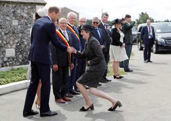 Britain's Prime Minister Theresa May greets Prince William and Catherine the Duchess of Cambridge as she arrives at Tyne Cot cemetery for commemorations for the 100th anniversary of the battle of Passchendaele near Ypres in Belgium