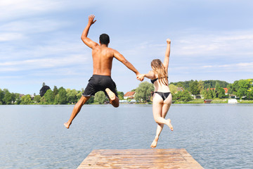 Couple Jumping Into Lake