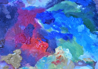 Blue and red abstract painters palette close up photo