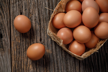 Egg in a basket on wooden table, Chicken Egg