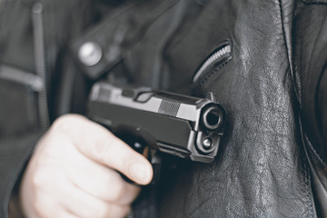 gun in a man hands attack