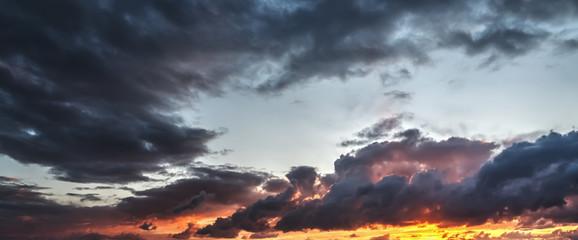 Dark clouds and orange sky