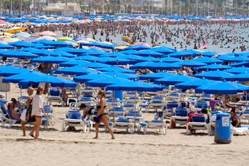 People enjoy the beach in the southeastern city of Benidorm