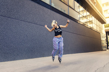 Cool young hipster woman enjoying, jumping with roller skates